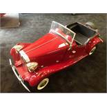 A Touchwood MG TD pedal car C1980s. Finely detailed fibreglass body measuring 126cm in length.