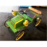 A Tri-ang De Dion Bouton pedal car C1960s. Finely detailed metal body measuring 90cm in length.