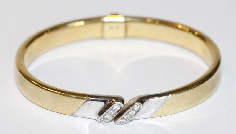 14 k Gelb- und Weißgold Armreif mit 8 in Weißgold gefaßten Diamanten, Klappscharnier, 21,4 gr., D