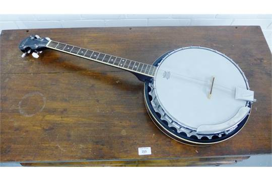 A Vintage rosewood cased Remo Weather King four-stringed