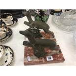 A pair of art deco deer on stands
