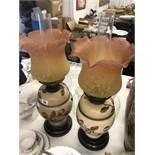A pair of Victorian oil lamps with shades