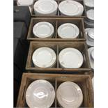 A large qty of white plates