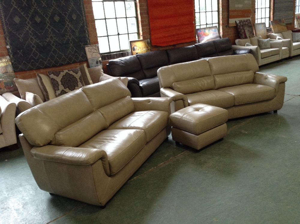 Lot 33A - 2 X CREAM LEATHER 3 SEATER SOFAS AND FOOTSTOOL (WM