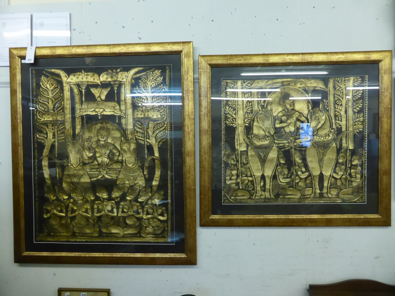 Lot 215 - Two large gilt framed Cambodian Angkor Wat wall rubbings.