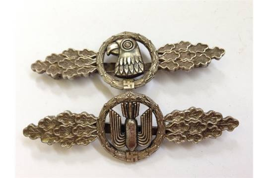 Two WWII German Nazi Luftwaffe badges, decorated with a