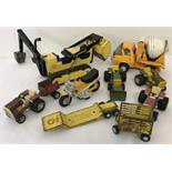 Nine vintage Tonka Toys. To include a cement mixer, scooter and a bulldozer.