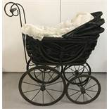 A reproduction vintage style dolls pram.
