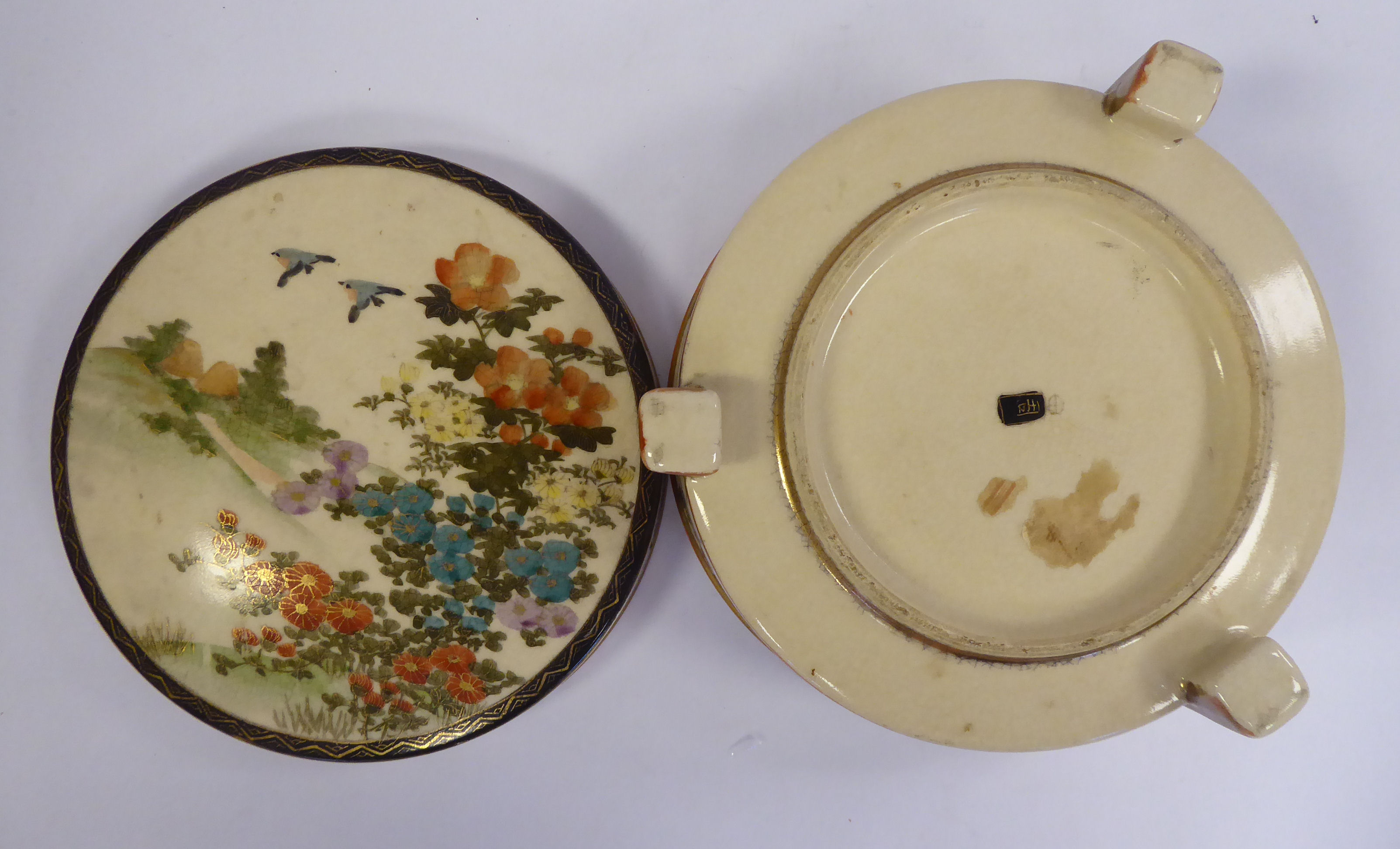 Lot 14 - An early 20thC Satsuma earthenware covered box, elevated on block feet, decorated with gilding,