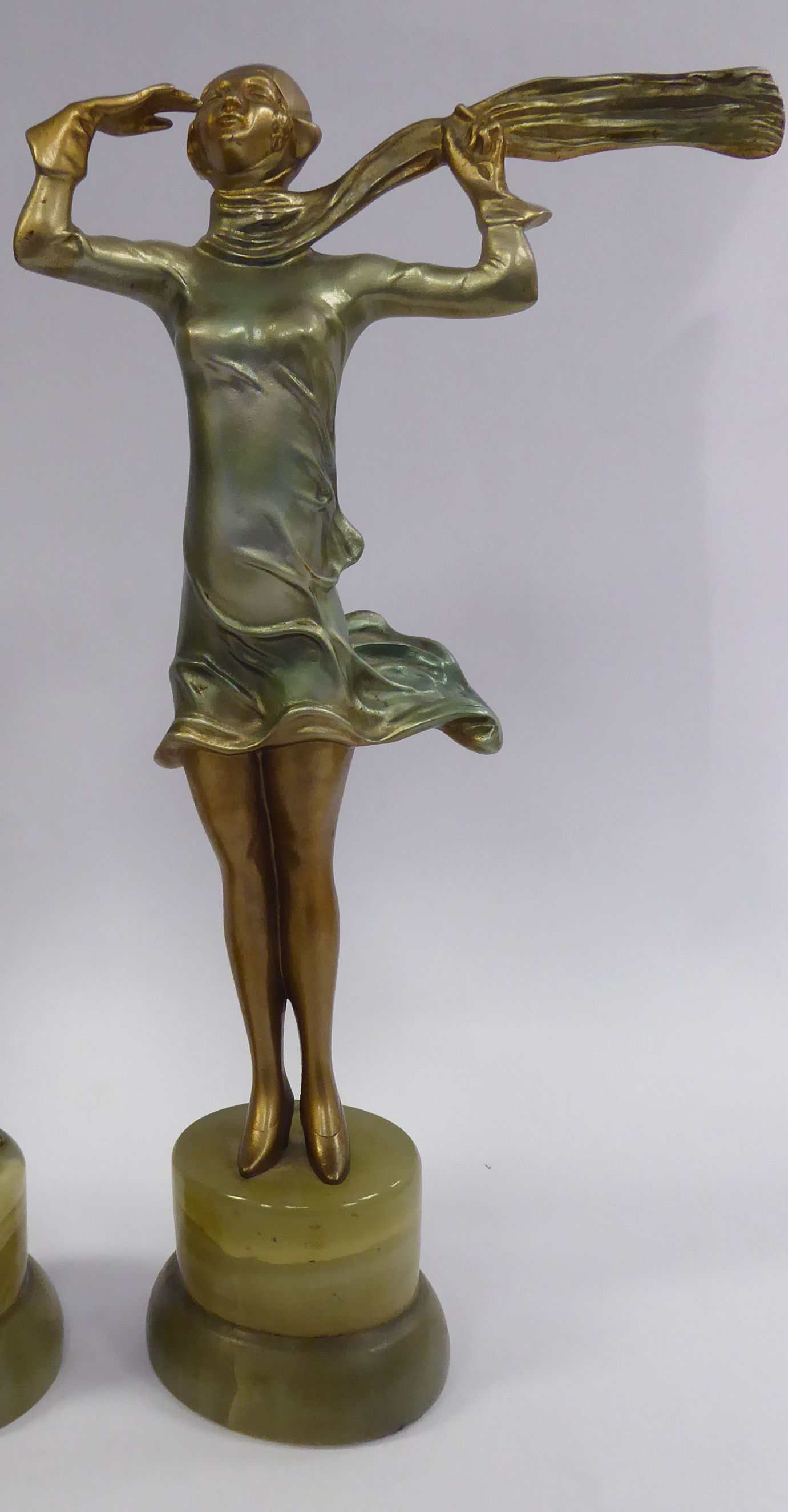 Lot 55 - A late 1920s/early 1930s painted cold cast figure, a fashionable young woman,