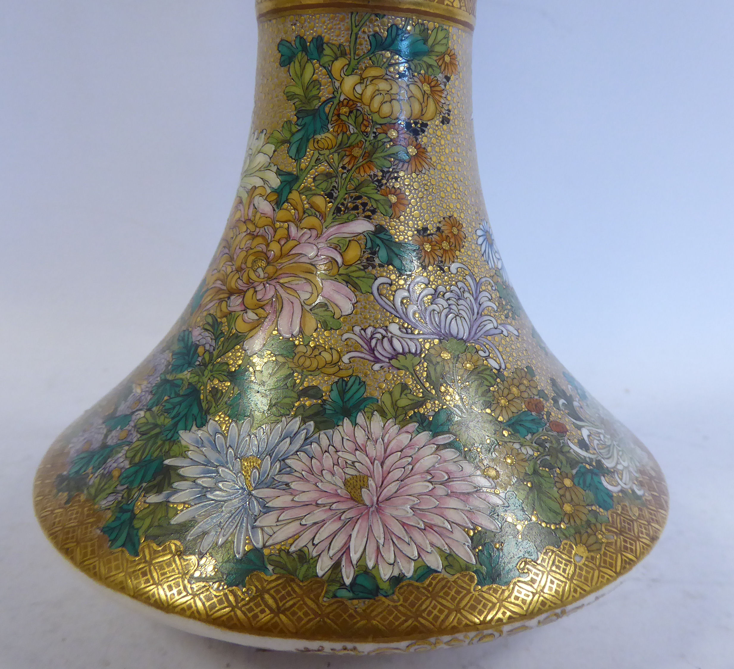 Lot 12 - A 20thC Satsuma floral decorated and gilded earthenware vase of waisted form with a wide neck and