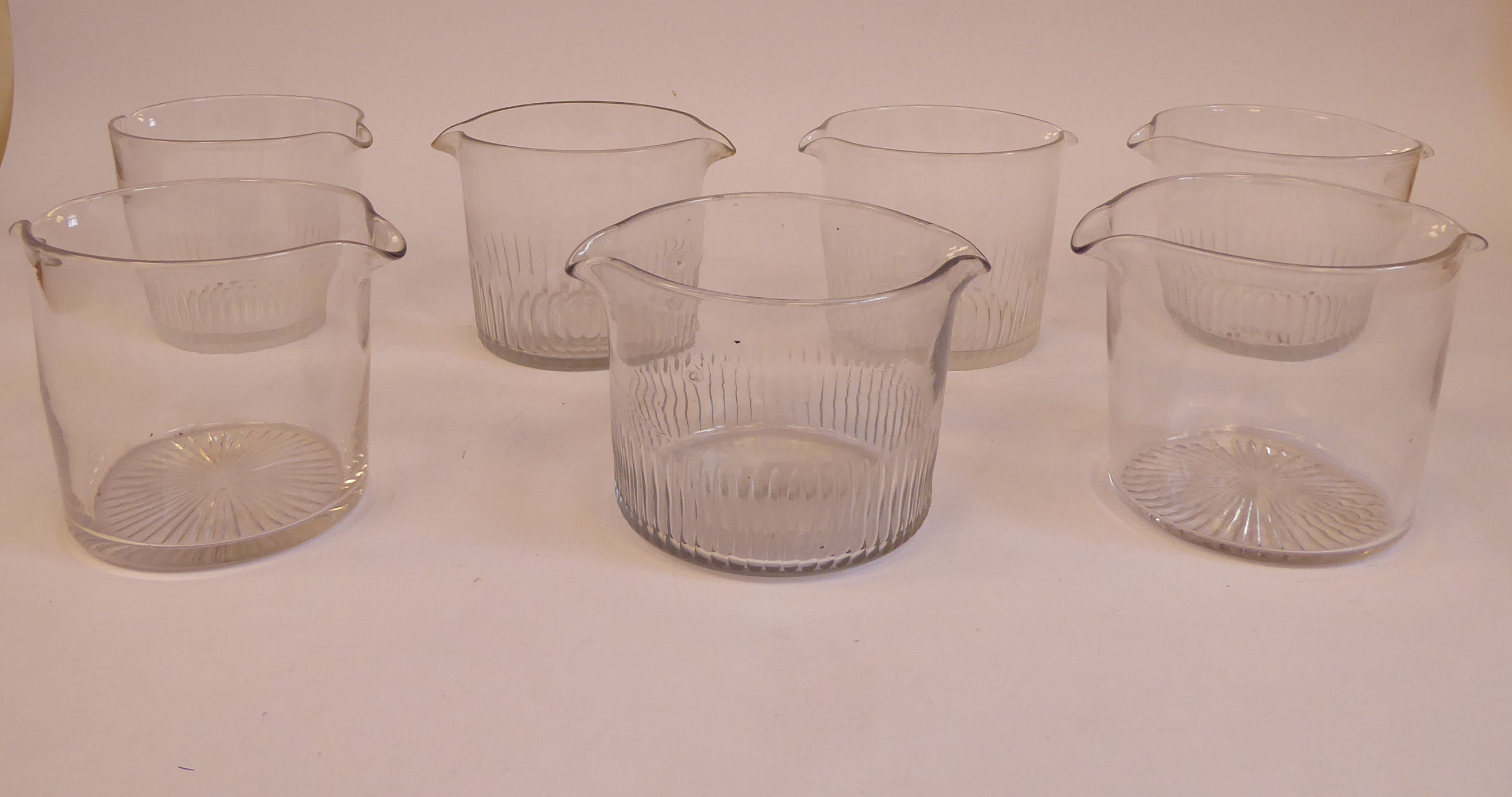 Lot 16 - A set of five mid 19thC with flute cut glass wine rinsers and a similar pair