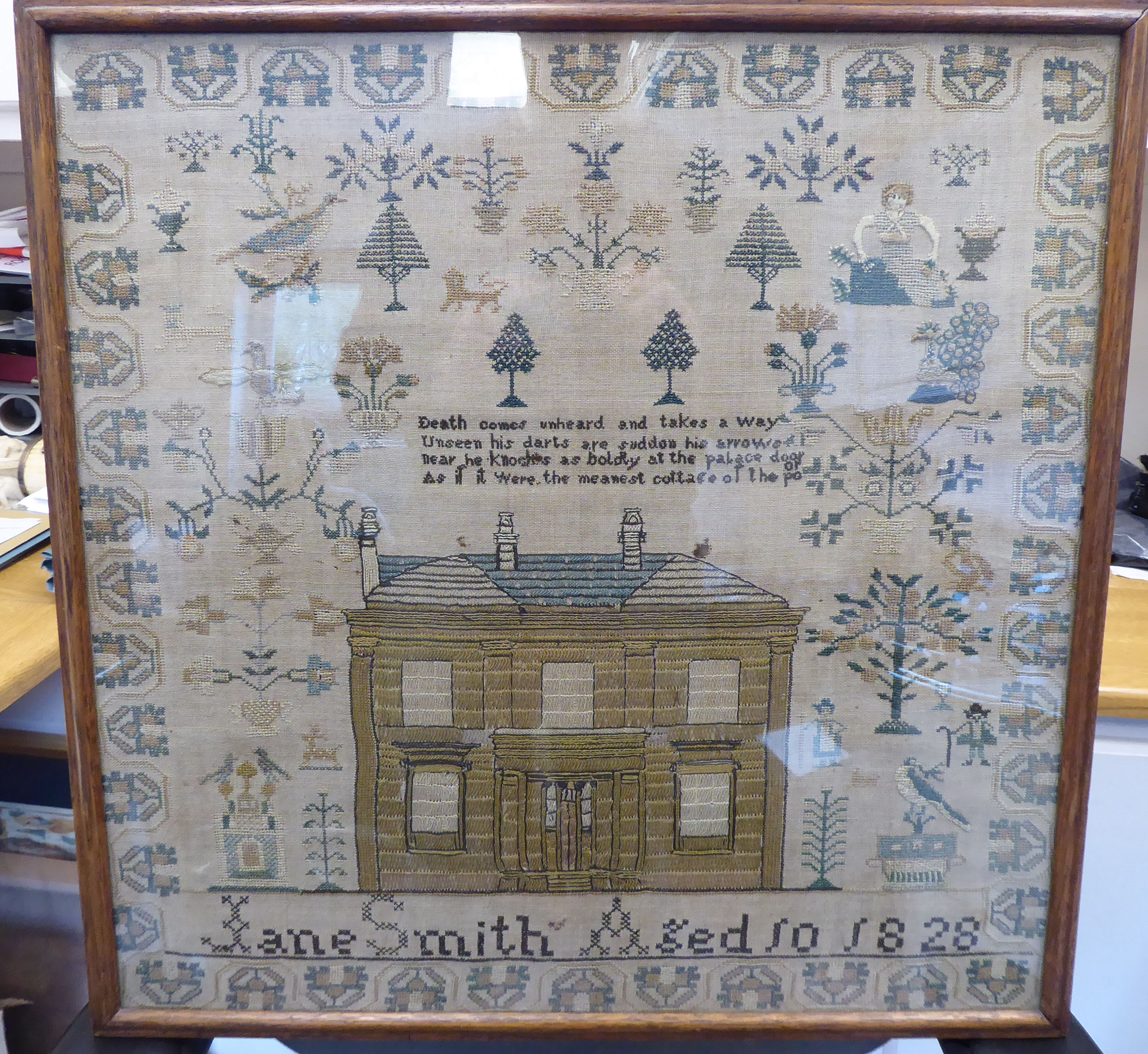 Lot 36 - A George IV sampler, featuring a two storey house, stylised trees, birds and border ornament,