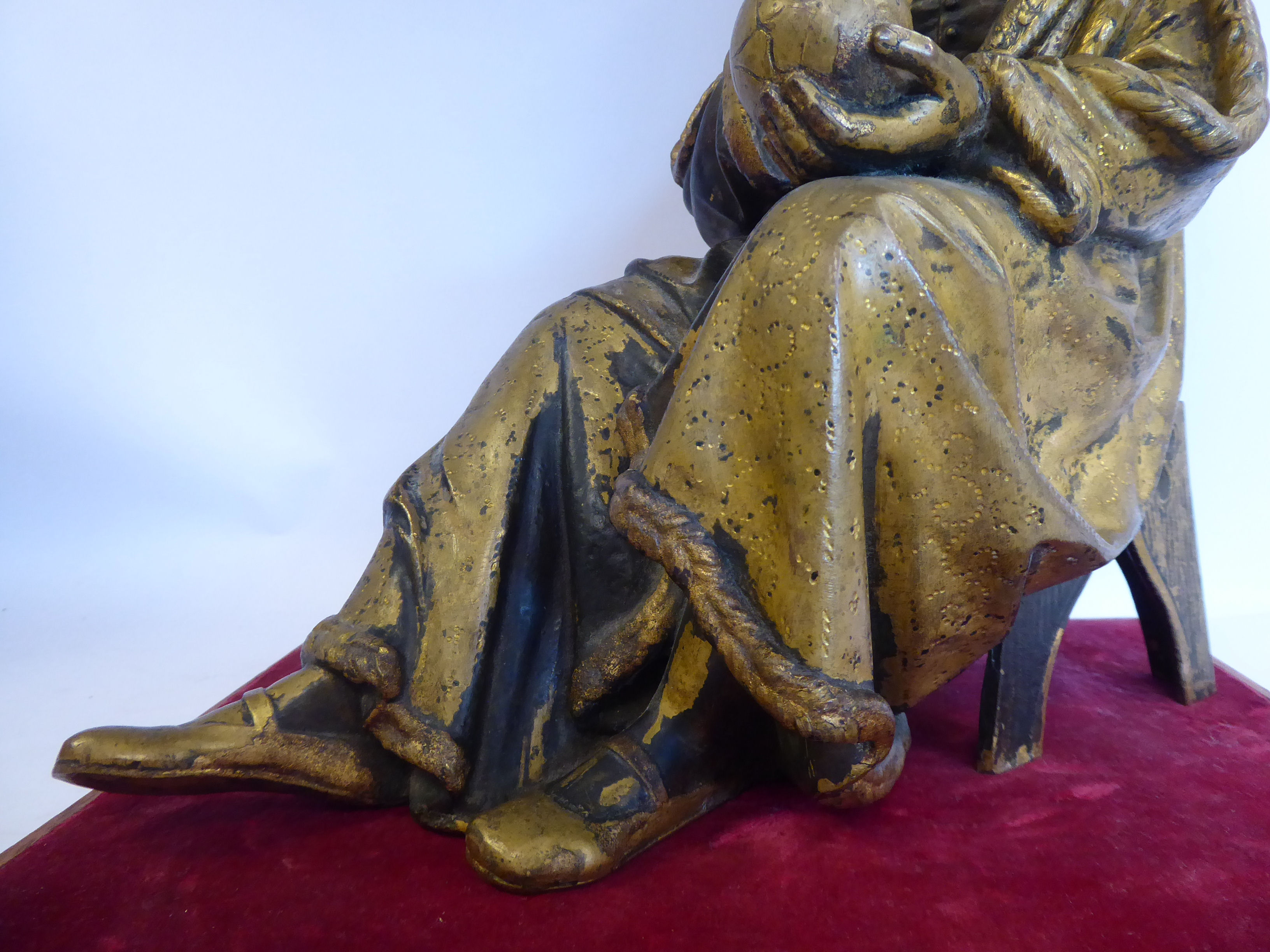 Lot 59 - A cast part gilt bronze figure, a seated, robed, bearded man, holding a globe 12.