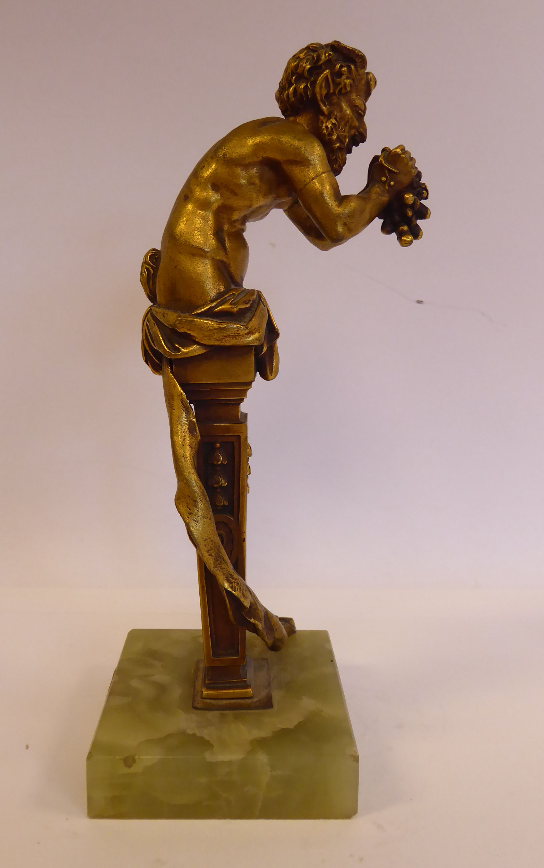 Lot 57 - A cast gilt bronze statue, Bacchus, on a tapered column and a square,