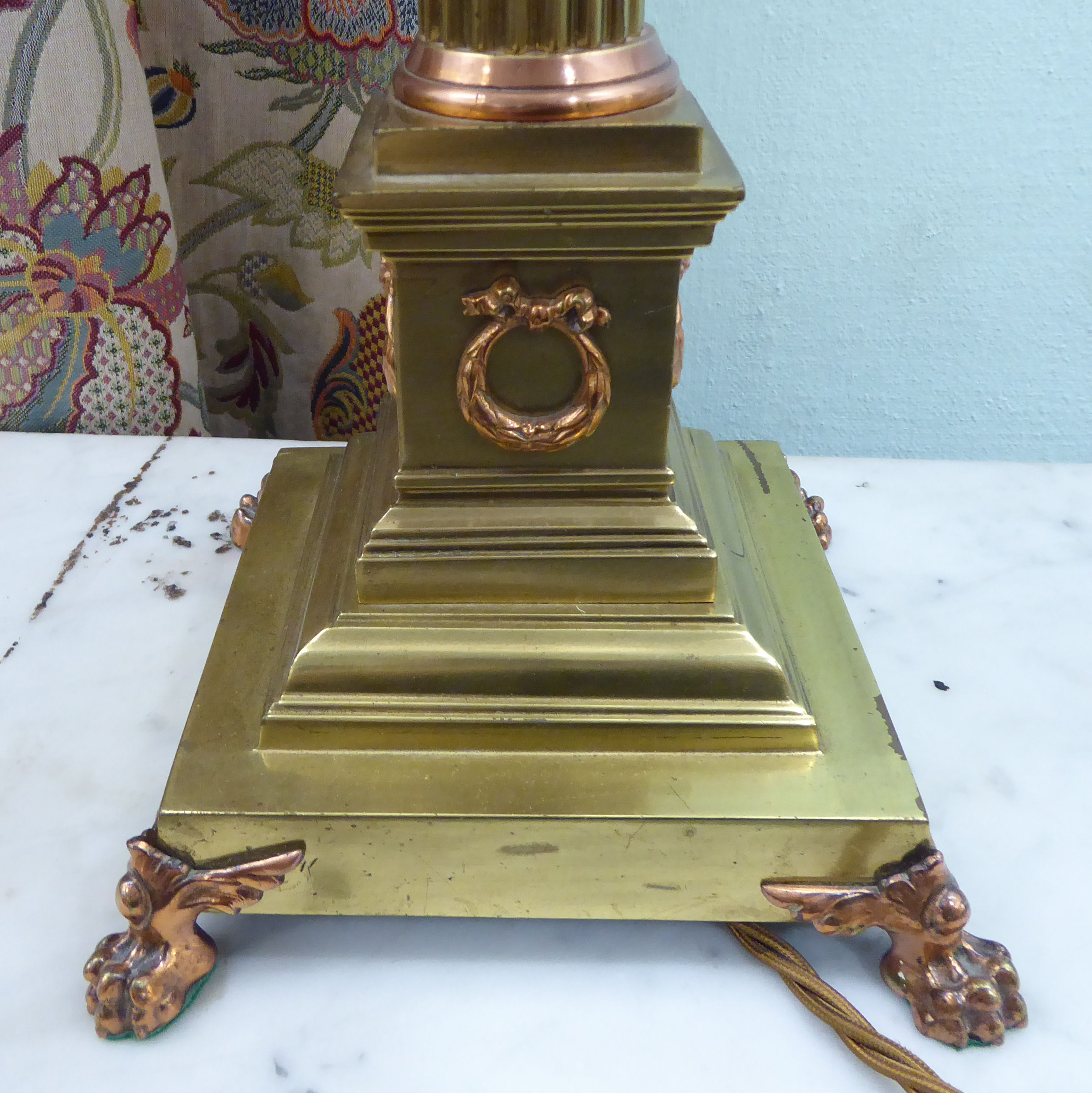 Lot 28 - An early 20thC lacquered brass and copper table lamp with a Corinthian capital,
