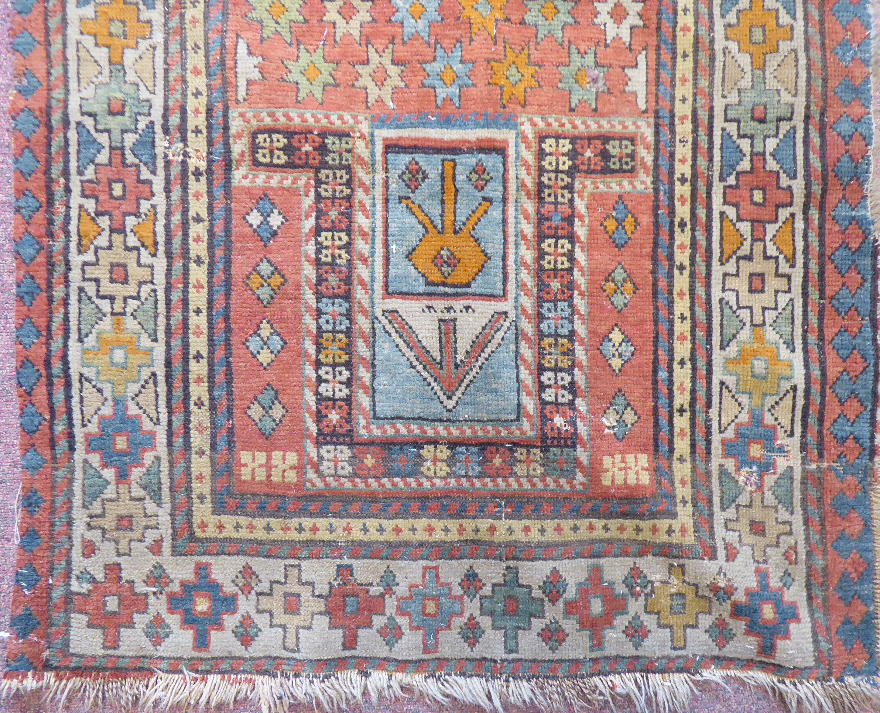 Lot 34 - A 19thC Turkish prayer rug, decorated with stars,