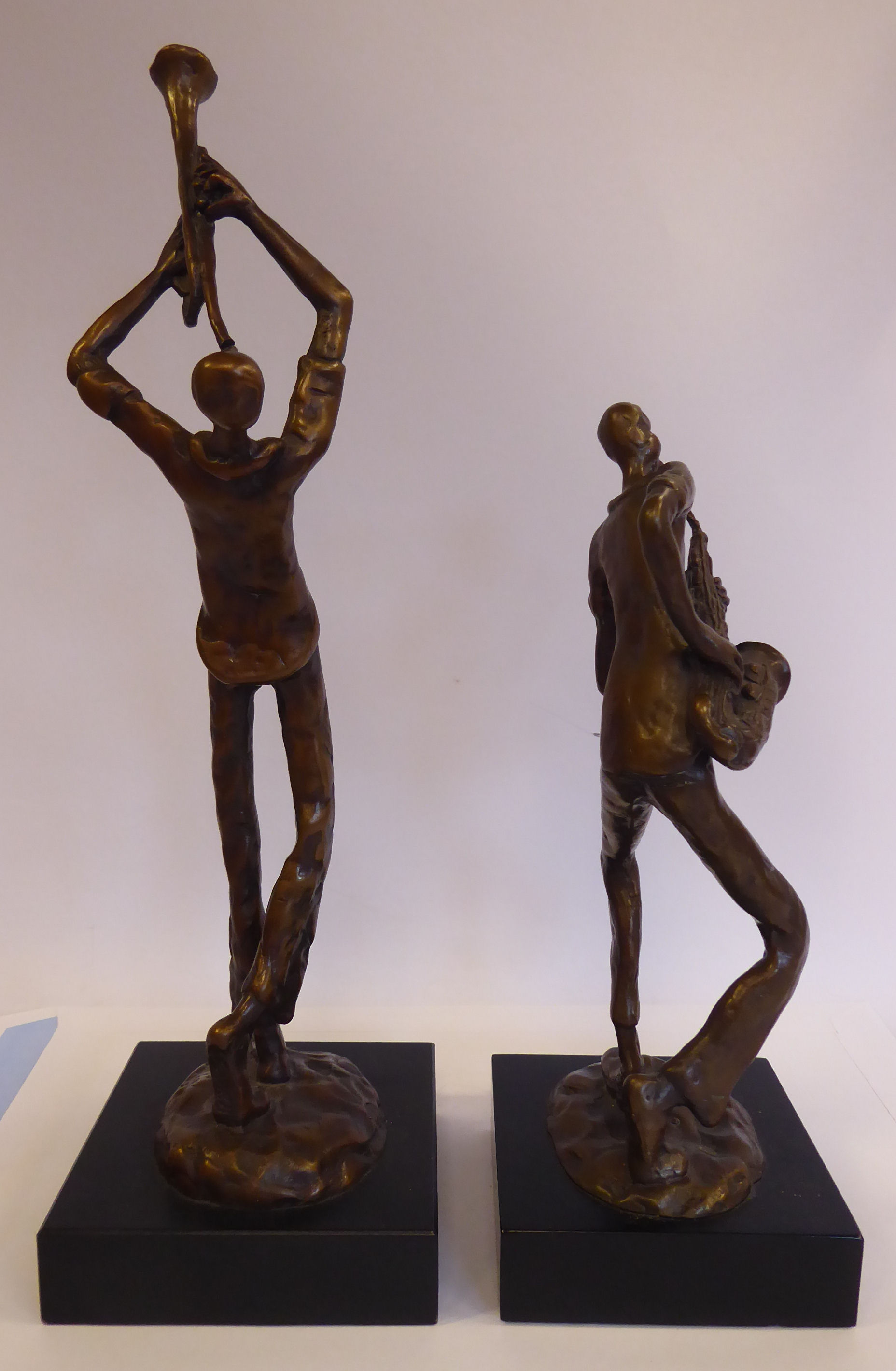 Lot 53 - Two cast and patinated bronze figures, one playing the trumpet,
