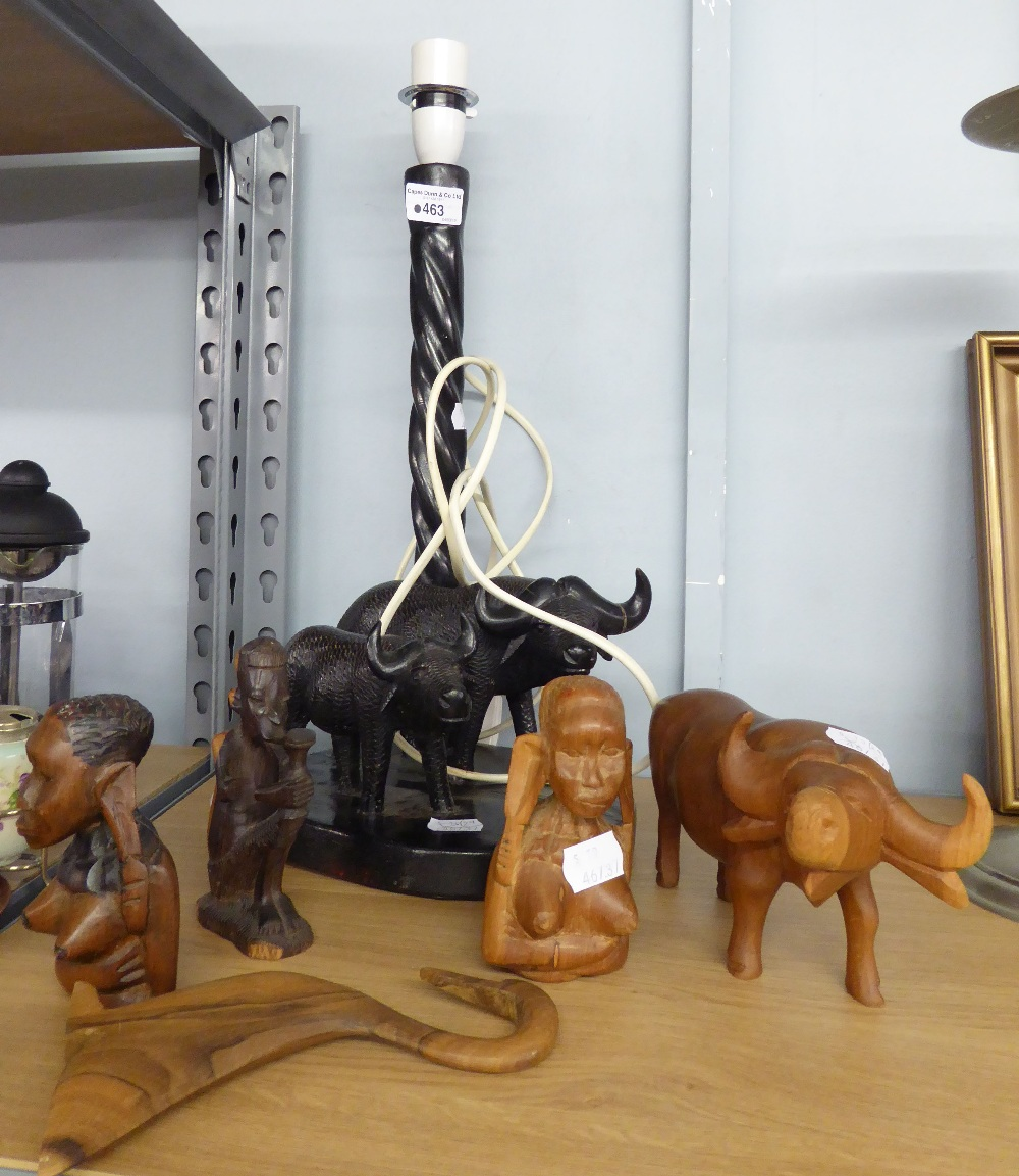 Lot 463 - AFRICAN CARVED EBONY TABLE LAMP WITH TWO CARVED OXEN TO THE OVAL BASE, together with THREE CARVED