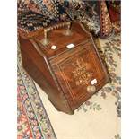 A Victorian inlaid rosewood coal box with brass fittings and shovel.