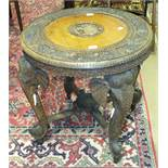 A late 19th/early 20th century carved hardwood circular table on elephant head supports, 69cm