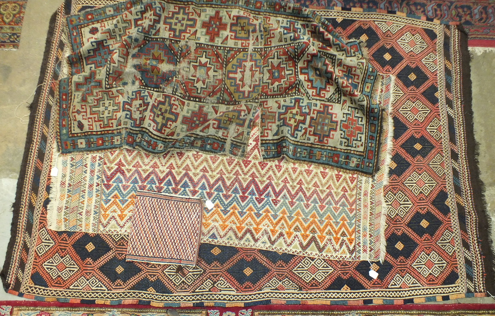 Three oriental rugs and a saddle bag (4).