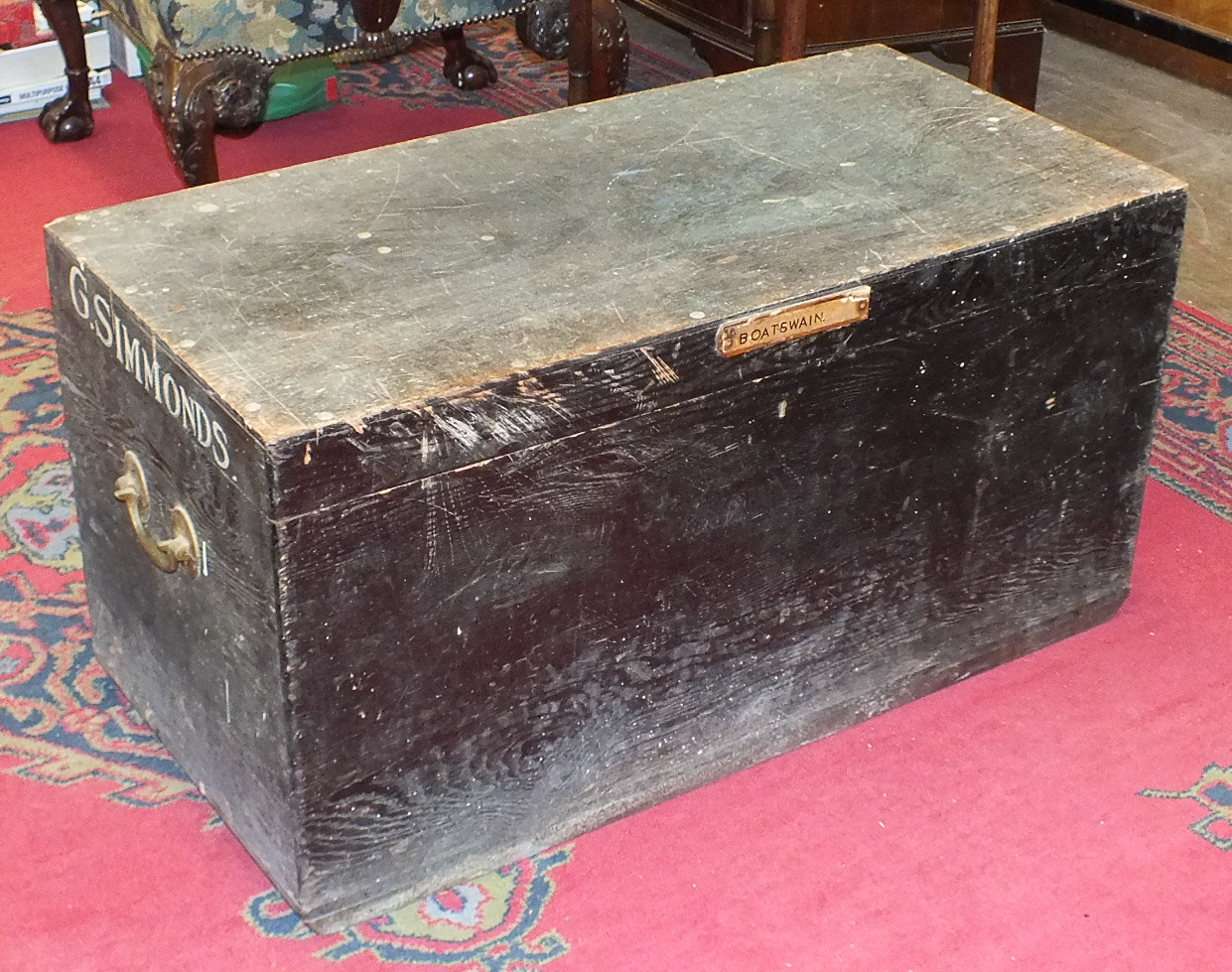 A stained pine tool box fitted with trays and brass carrying handles, 95cm wide, together with a