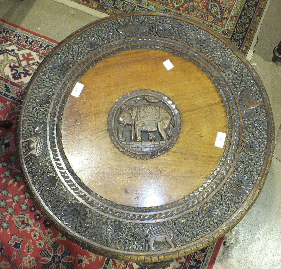 A late 19th/early 20th century carved hardwood circular table on elephant head supports, 69cm - Image 2 of 3