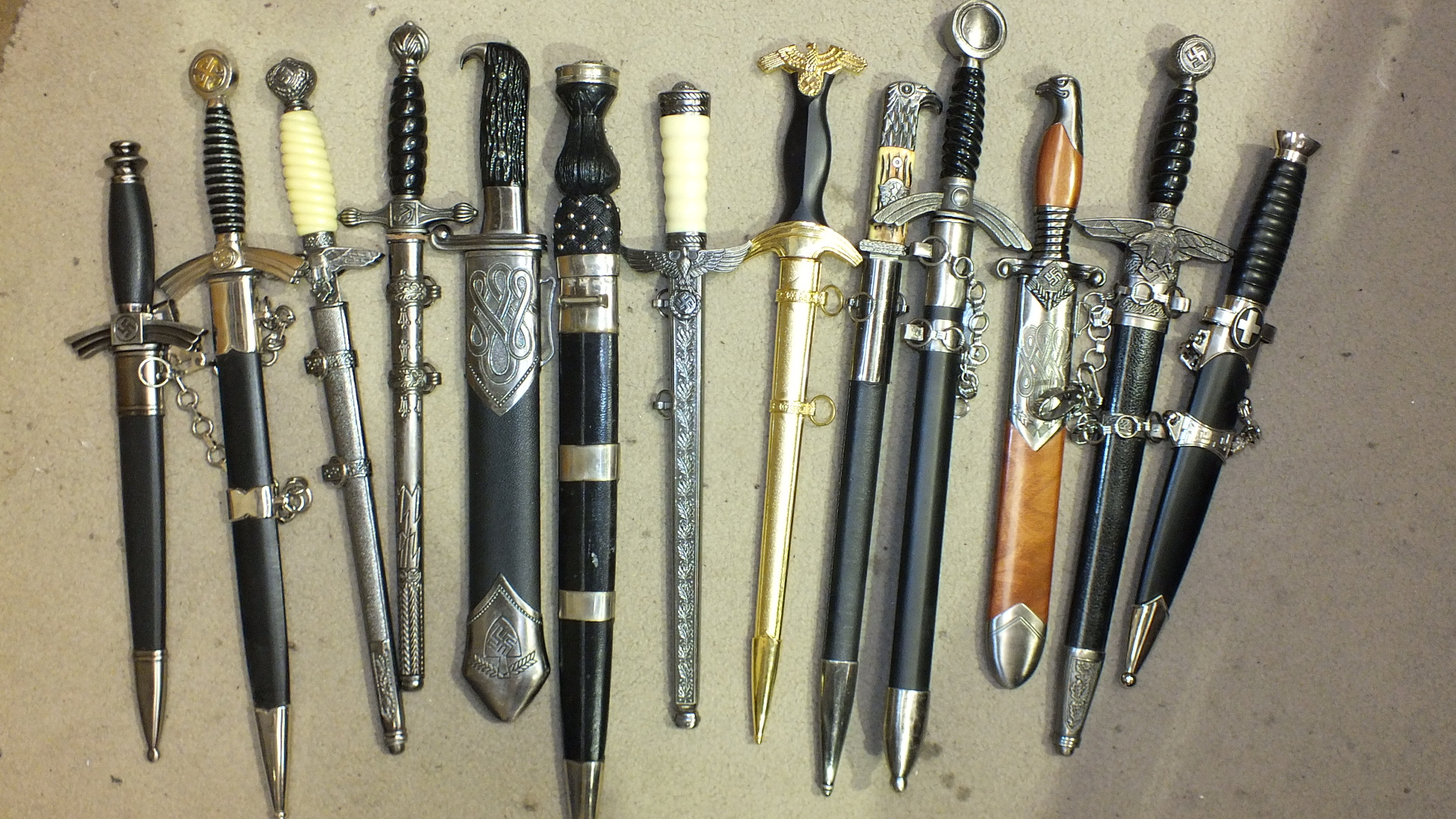 A collection of thirteen reproduction German military dirks and daggers, (13).