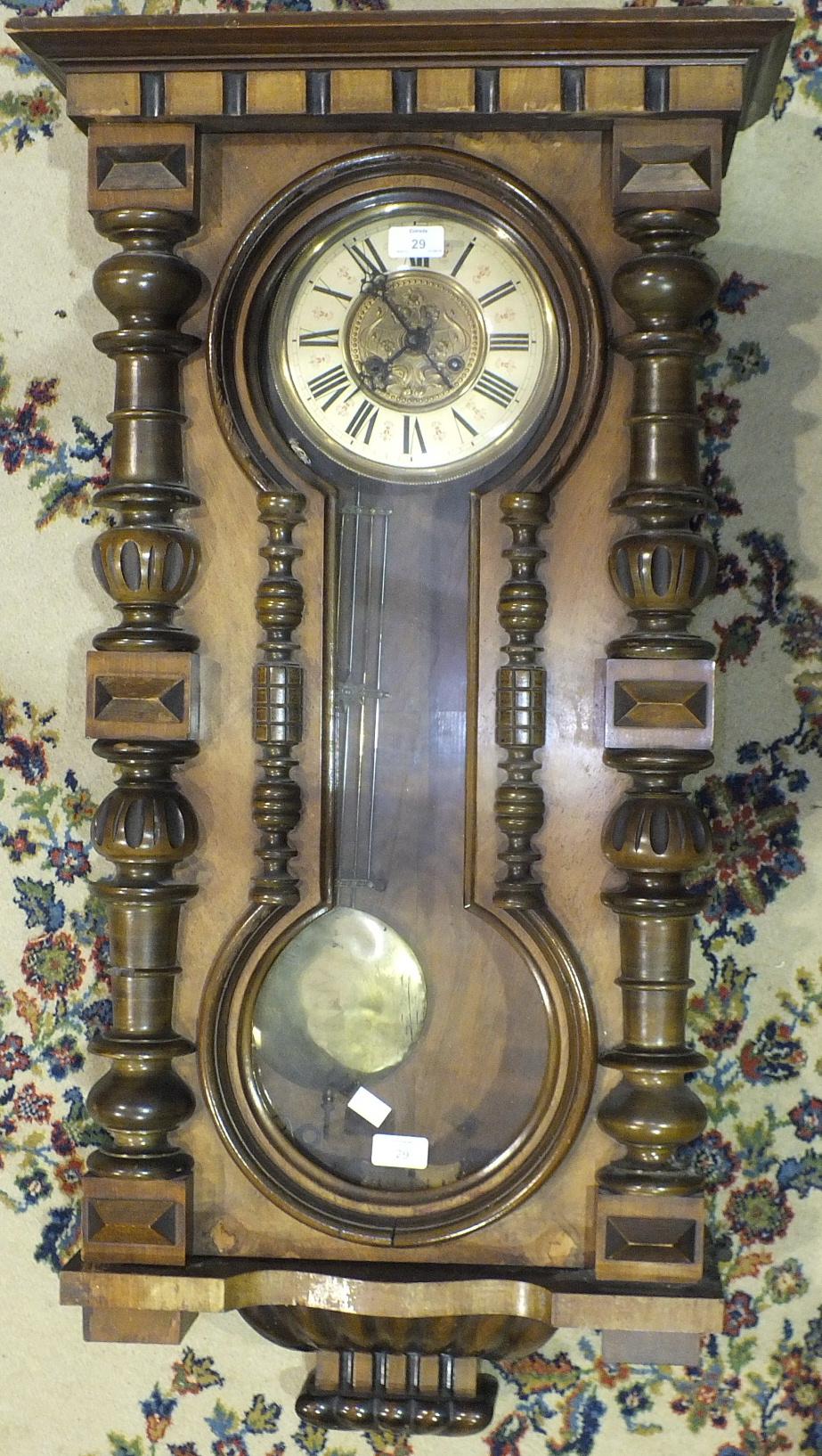 A Walnut cased Vienna style wall clock, 100cm high.