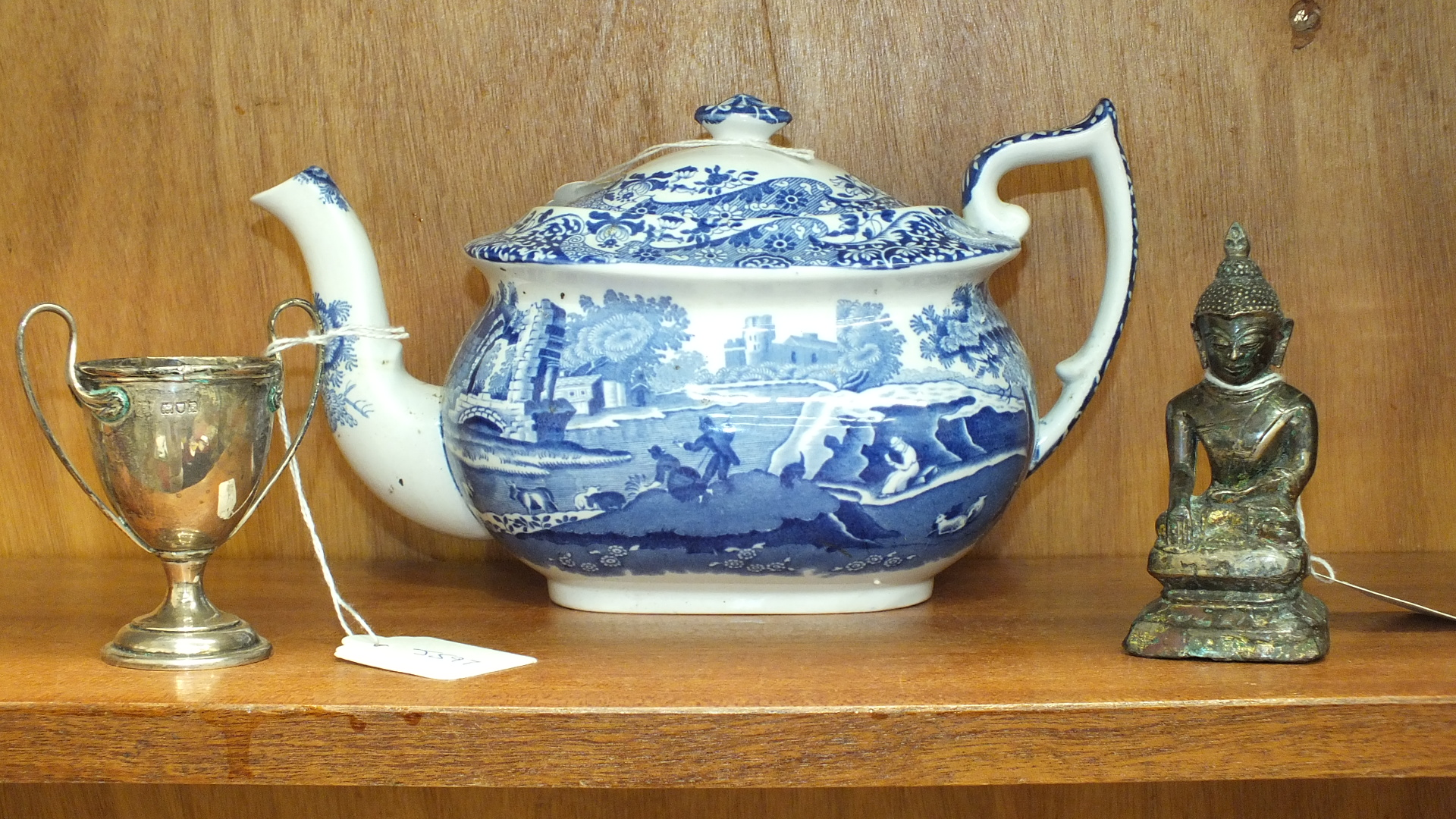 "A Copeland Spode ""Italian"" pattern blue and white teapot, a small silver two-handled trophy cup"