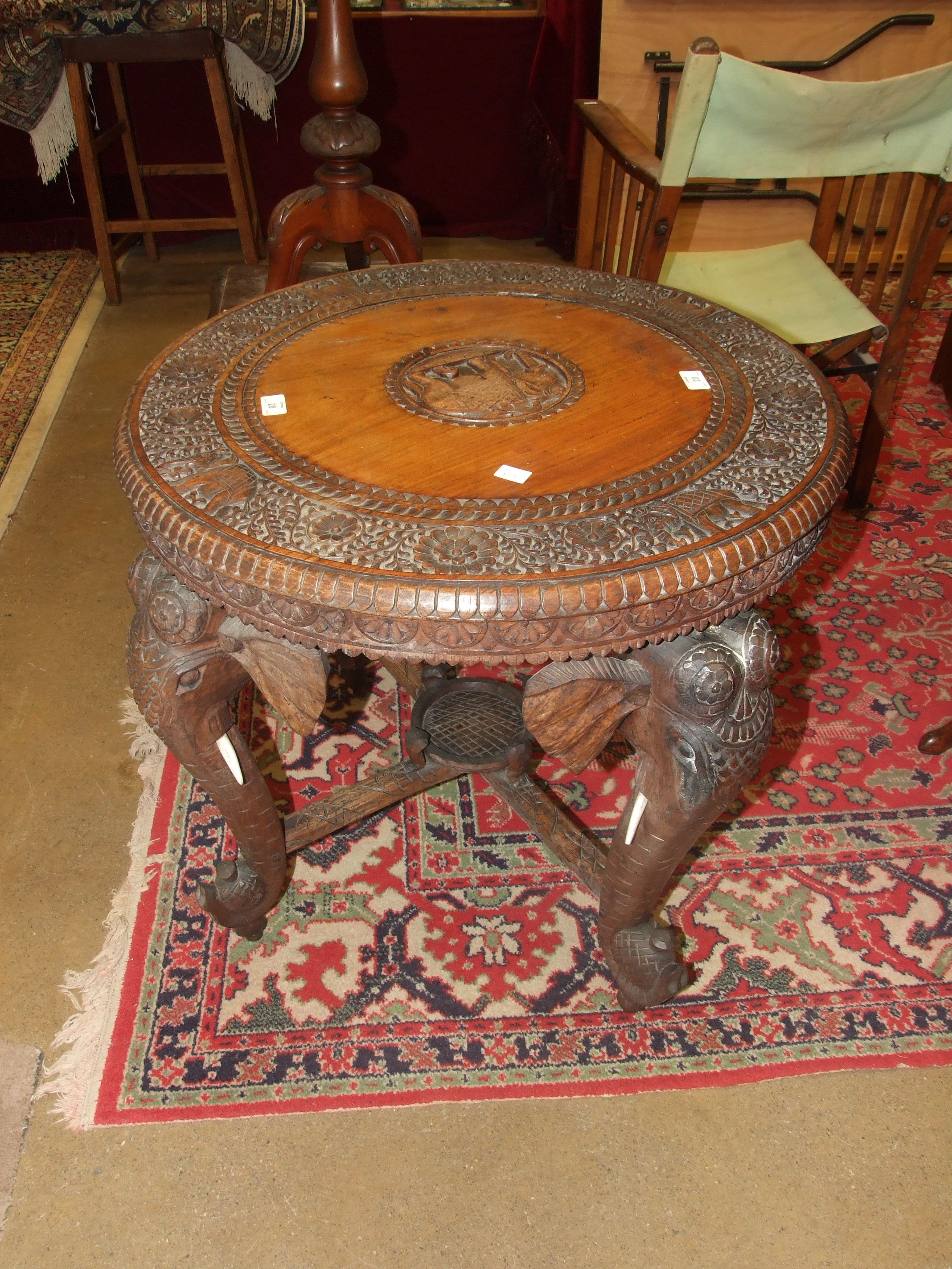 A late 19th/early 20th century carved hardwood circular table on elephant head supports, 69cm - Image 3 of 3