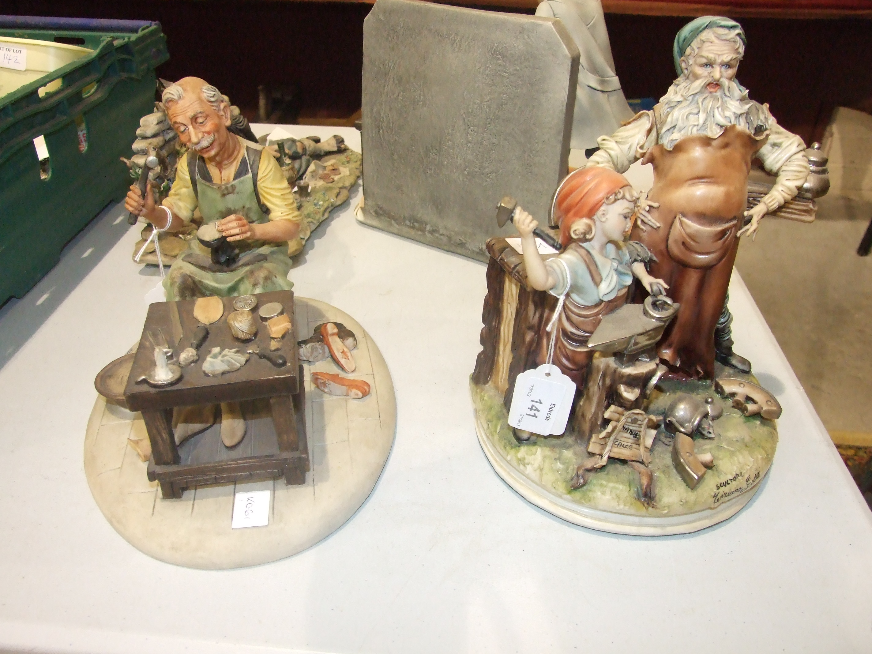 "Lot 141 - A modern Capo di Monte figure group, ""The Barber"" by Corti, 22cm high, another, ""The Cobbler"" and"