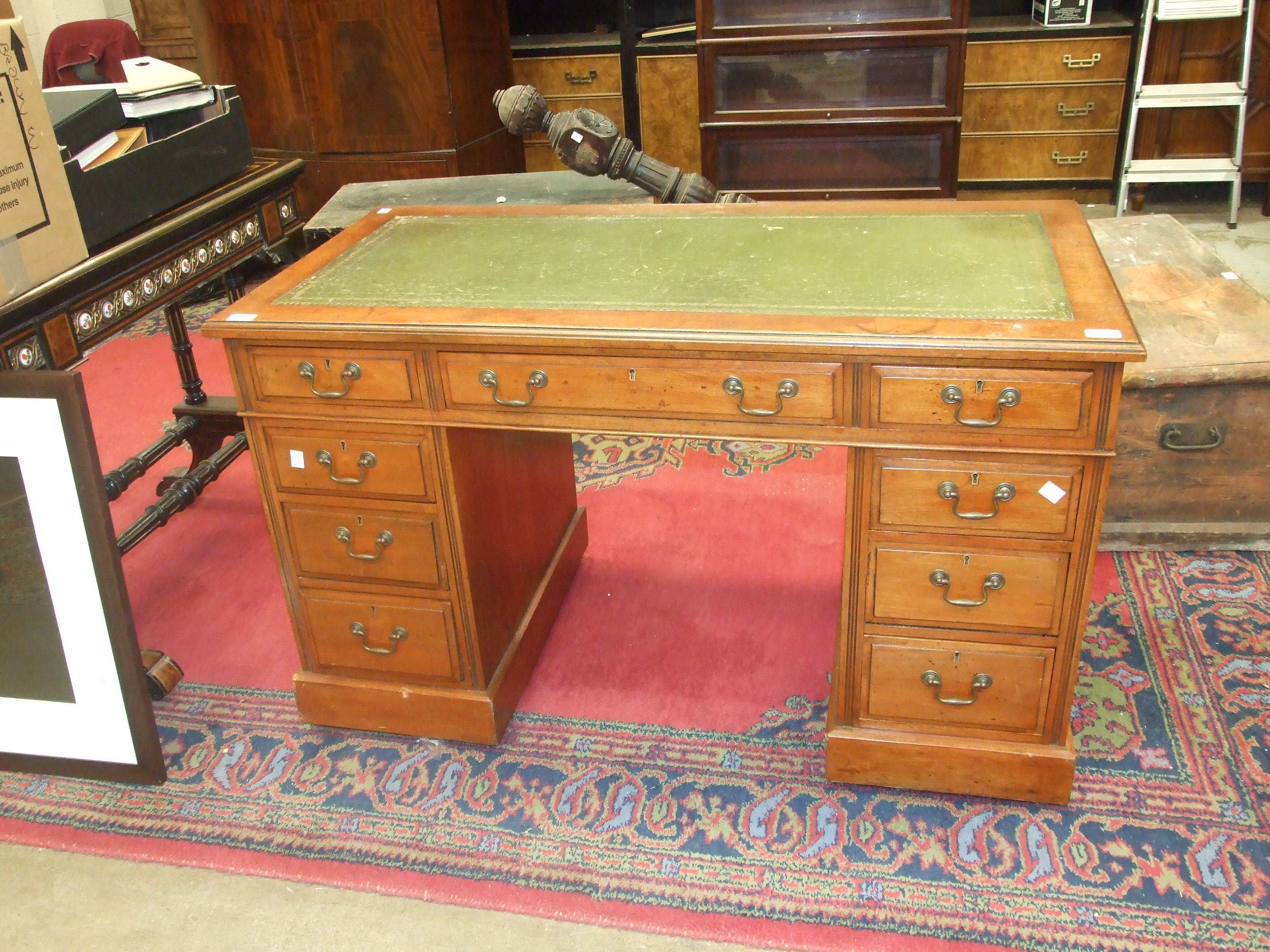 An Edwardian stained mahogany knee-hole desk, the rectangular top with writing inset, and three - Image 2 of 2