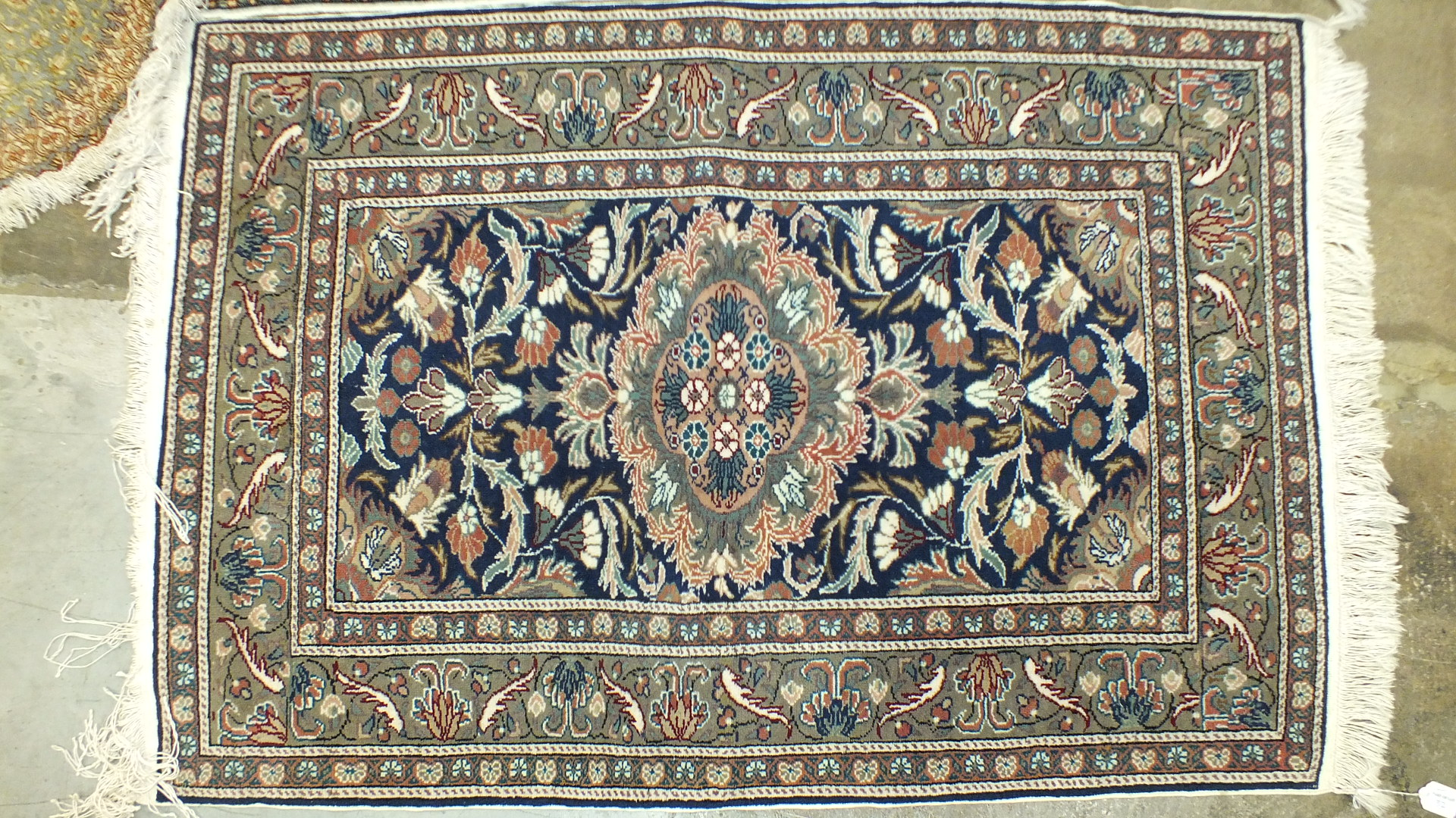 Lot 32 - A small silk floral patterned hearth rug, 94 x 63cm, two other oriental rugs and a stained wood high