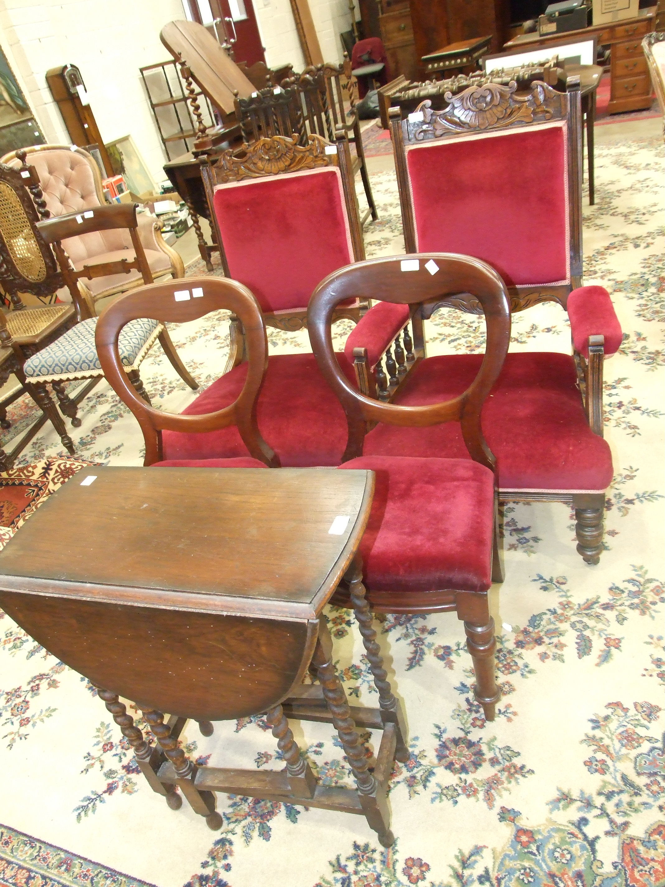 A pair of Victorian upholstered dining chairs, two Edwardian salon chairs and two occasional tables,