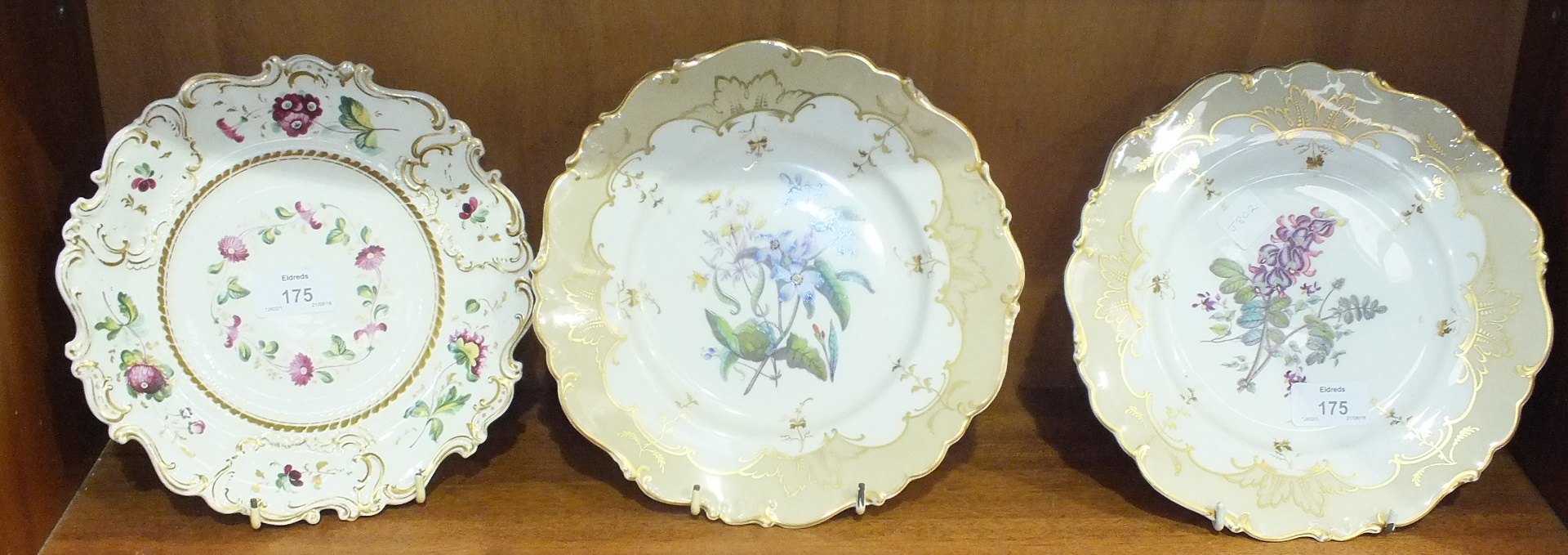 Lot 175 - A pair of 19th century English floral painted porcelain plates, 23cm diameter and one other, (3).