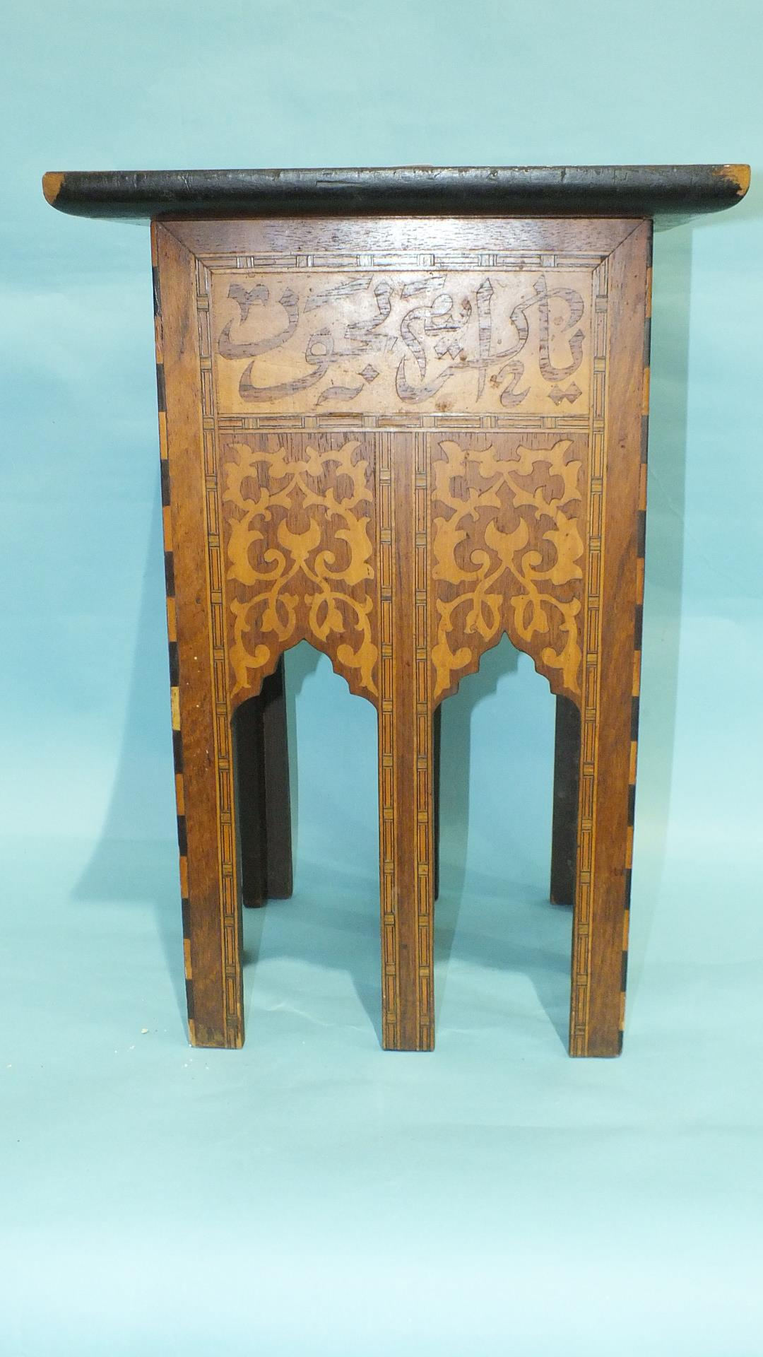 An early-20th century Persian hardwood square table with overall marquetry decoration, the top