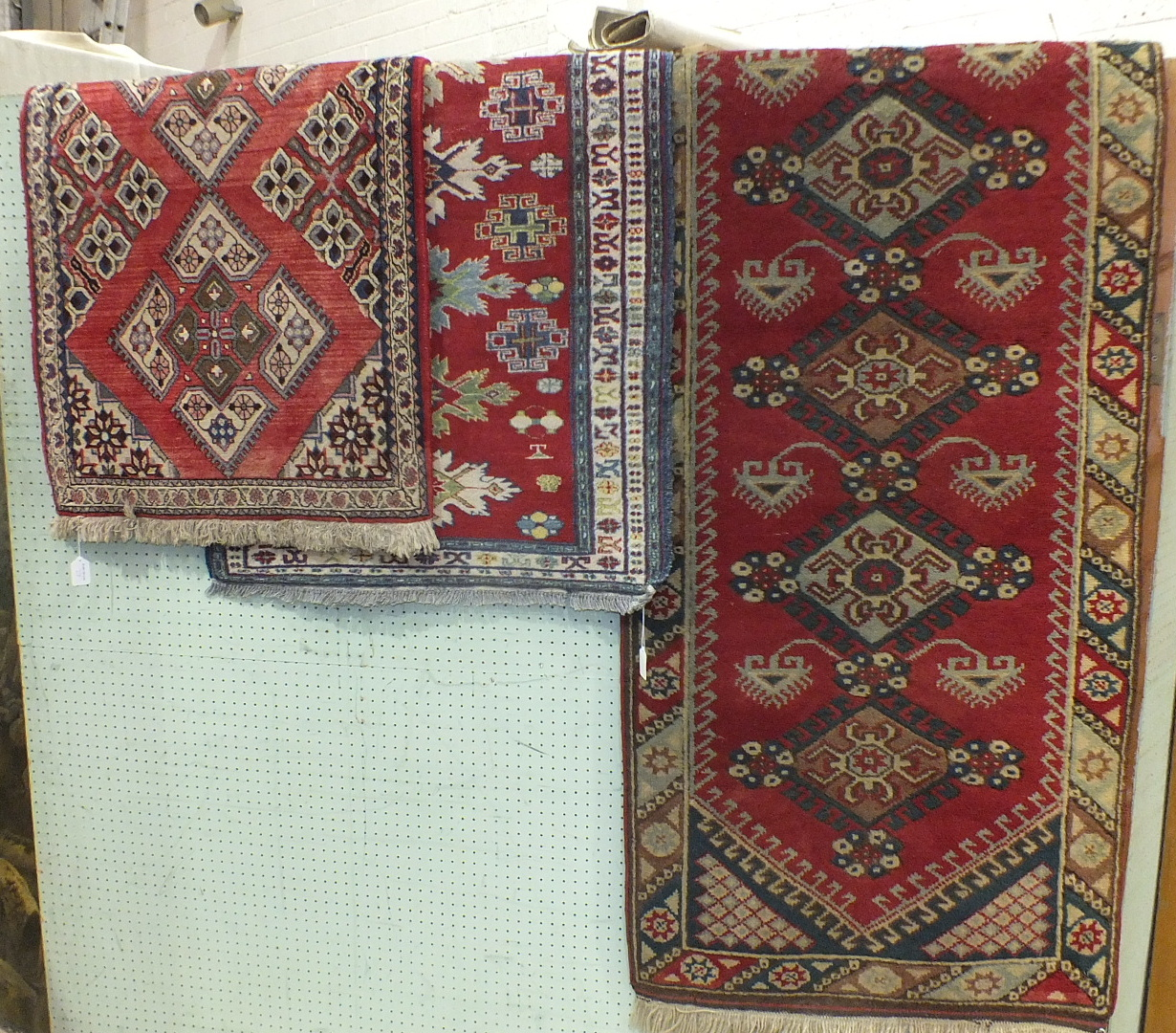Lot 27 - A Turkey runner, 266 x 75cm and two Oriental rugs, (3).