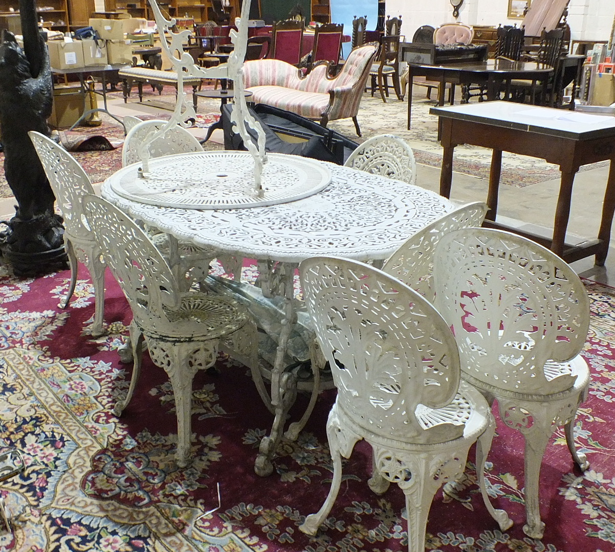 A painted metal garden-table of pierced foliate design, 140cm long, together with eight chairs and a - Image 2 of 2