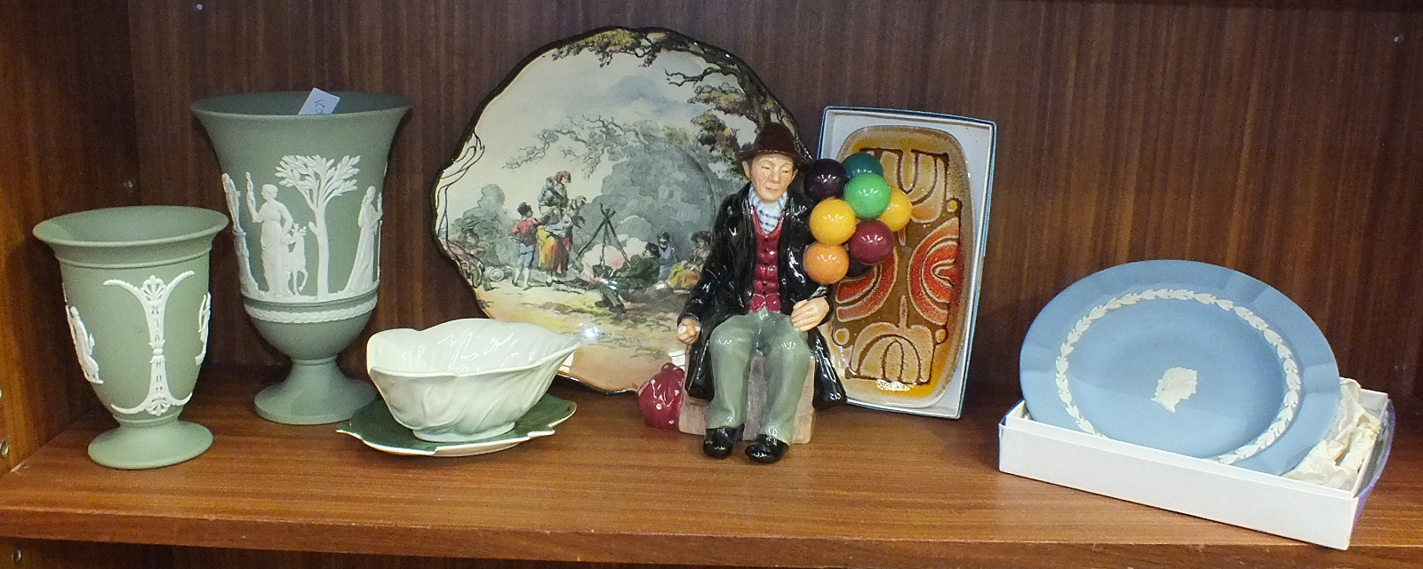 Lot 110 - A Royal Doulton figurine 'The Balloon Man' HN1934, 20cm, two Royal Doulton 'English Old Scenes'