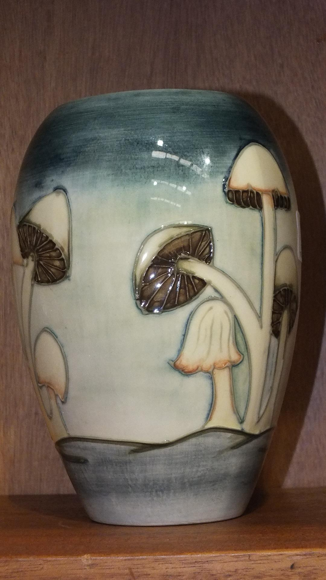Lot 171 - A Moorcroft 'Fairy Rings' pattern ovoid shape vase decorated with toadstools on a blue and mottled