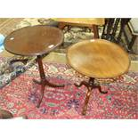 Two mahogany circular occasional tables on tripod supports, 51 and 56cm diameter, (2).