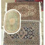 A small silk floral patterned hearth rug, 94 x 63cm, two other oriental rugs and a stained wood high
