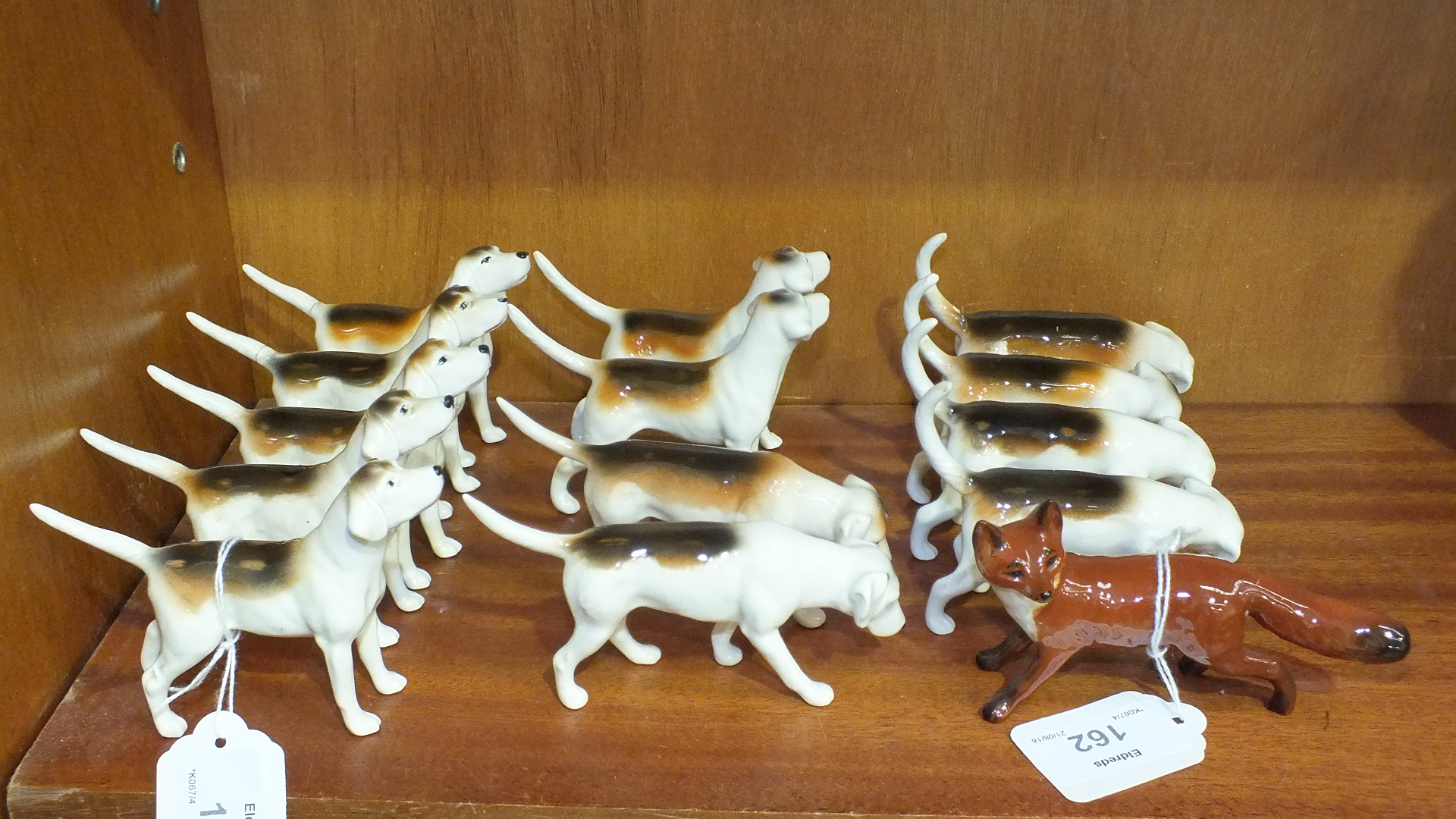 Lot 162 - A collection of thirteen various Beswick foxhounds, some af, and a standing fox, 6.5cm, (14).