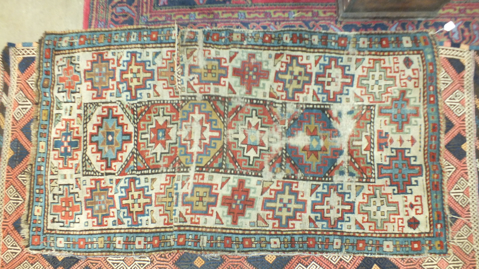Three oriental rugs and a saddle bag (4). - Image 2 of 4