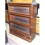 A Globe Wernicke-style three-tier stained mahogany bookcase with base drawer, 86cm wide, 106cm