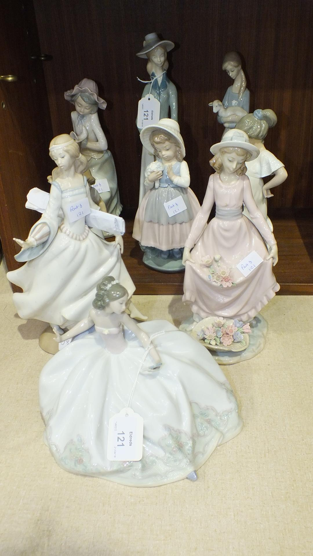 Lot 121 - A Lladro ballerina figurine, three others (af), and a group of five Nao figurines, (9).