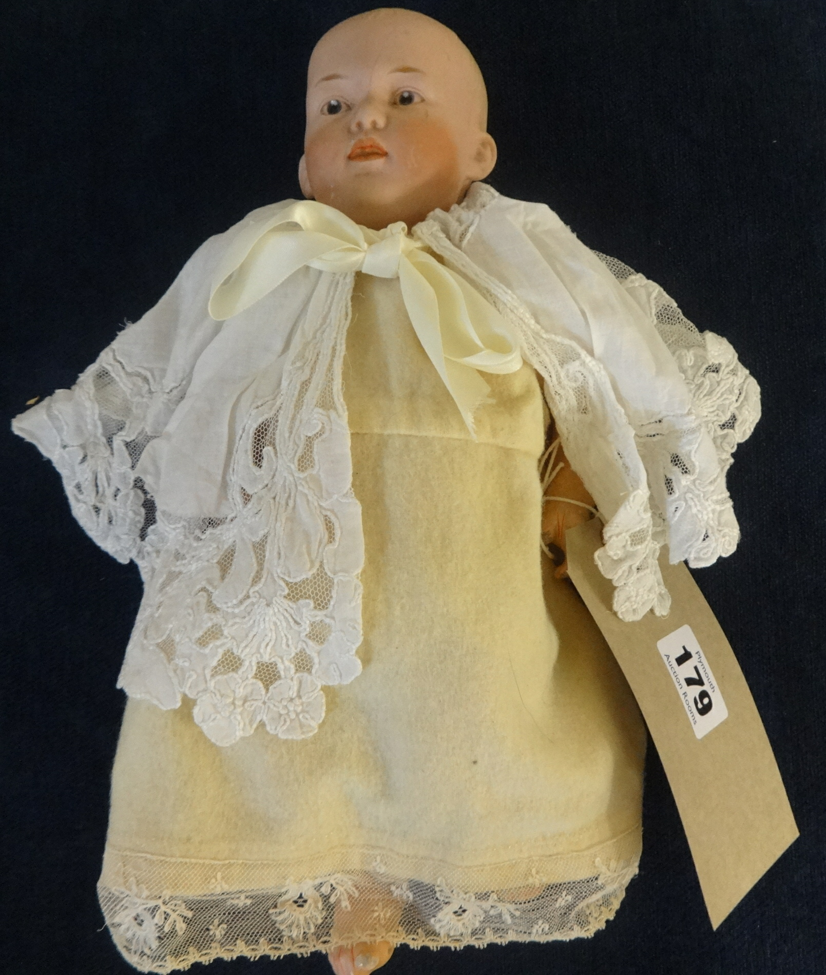 Lot 041 - A German bisque head doll (head damaged), marked 'No4' with composition body, height approx 30cm