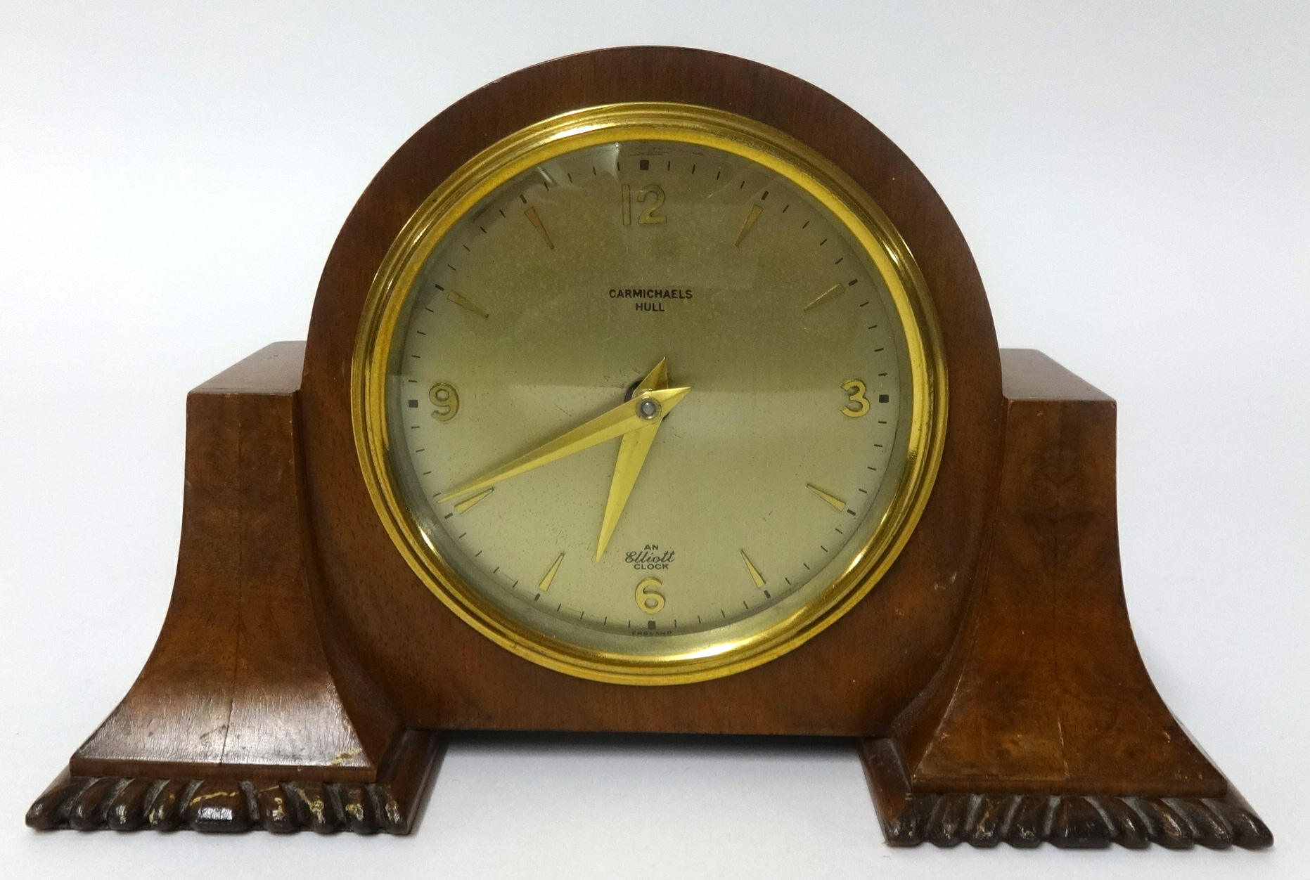 Lot 056 - An Elliott walnut cased mantel clock, inscribed 'Carmichael', height 12cm.